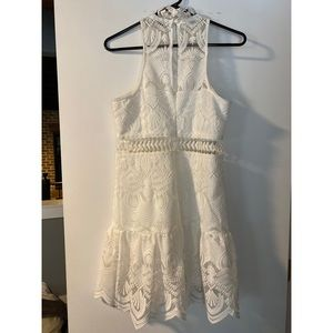 White mini dress with lace detail